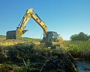 Seepage ditch cleaning with excavator