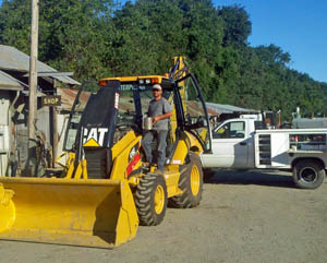 CAT Backhoe Being Serviced
